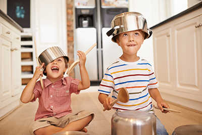 kids playing on kitchen floor